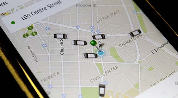 In this Wednesday, March 18, 2015, file photo, the Uber app displays on a smart phone cars available for a pick up in downtown Manhattan. A new law meant to regulate and tax ride-sharing services like Uber and Lyft will need to be clarified when legislators reconvene in Annapolis in January. (AP Photo/Mary Altaffer, File)