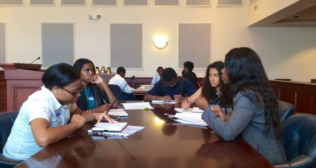 "The 20 high school students participating in the ""Just the Beginning"" program spent Wednesday afternoon at the Edward A. Garmatz U.S. District Courthouse in Baltimore developing oral arguments for a hypothetical search-and-seizure case. (Lauren Kirkwood/The Daily Record)"