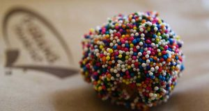 "(Flickr / Ken Hawkins /""Tasty donut covered in tasty colorful balls"" / CC BY 2.0)"