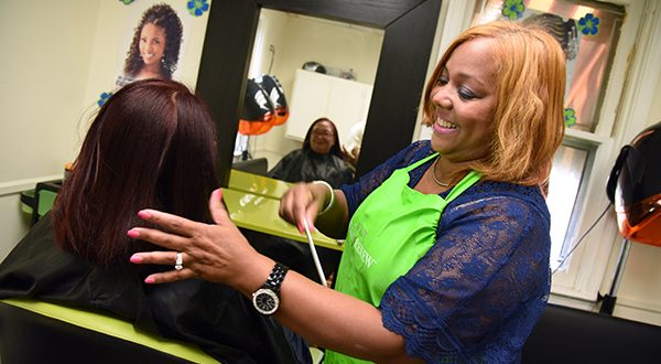 Maritza Guerrero, owner of New York Dominican Beauty Salon, works on the hair of Francisca Ventura at the salon's Windsor Mill location. Guerrero received a $5,000 loan from the Latino Economic Development Center to help offset the revenue she lost during the rioting and unrest in Baltimore. (Photo by Maximilian Franz / The Daily Record)