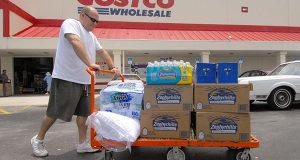 Jay Hollander of West Palm Beach, Florida,  pushes a cart loaded with his purchases outside the Costco Wholesale Club store in Lake Park, Florida in 2006.  (Mark Elias/Bloomberg News)