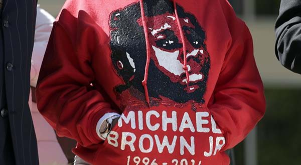 In this April 23, 2015 file photo, Lesley McSpadden, the mother of Michael Brown, wears a sweatshirt remembering her son during a news conference in Clayton, Mo. A majority of blacks in the U.S., more than three out of five, say they or a family member have personal experience with being treated unfairly by the police, and their race is the reason. The parents of Michael Brown filed a wrongful-death lawsuit Thursday against the city of Ferguson, Mo., over the fatal shooting of their son by a white police officer, a confrontation that sparked a protest movement across the U.S. (AP Photo/Jeff Roberson, File)