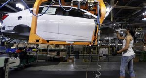 A Buick Verano is assembled at General Motors' Orion Assembly plant in Orion Township, Mich., June 22. (AP Photo/Carlos Osorio)