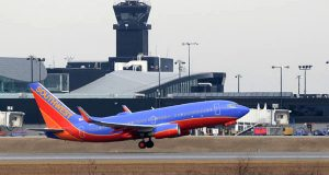 A Southwest plane uses a runway in February 2014 at Baltimore Washington International Thurgood Marshall Airport. (The Daily Record/Maximilian Franz)