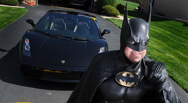 In this March 27, 2012, photo, Leonard Robinson, dressed as Batman, poses for a photo outside his home, in Owings Mills. Authorities say, Robinson, known for visiting hospitalized children dressed in his Batman costume, died, Sunday in a crash on Interstate 70, in western Maryland. (Jonathan Newton/The Washington Post via AP)