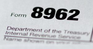 A health care tax form 8962 is seen in Washington. Sign-up season for President Barack Obama's health care law doesn't start for another couple of months, but the next few days are crucial for hundreds of thousands of customers who risk losing financial aid when they renew for 2016.  (AP Photo/Carolyn Kaster)