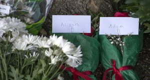 Flowers, balloons and cards are left for the staff of WDBJ7 as well as cards for Alison Parker and Adam Ward in front of WDBJ's location in Roanoke, Va., Wednesday, Aug. 26, 2015. Vester Lee Flanagan opened fire during a live on-air interview for WDBJ7, killing the two journalists Wednesday. (Don Petersen/The Roanoke Times via AP)