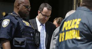 former subway pitchman Jared Fogle leaves the federal courthouse in Indianapolis in August following a hearing on child-pornography charges. Fogle agreed to plead guilty to allegations that he paid for sex acts with minors and received child pornography in a case that destroyed his career at the sandwich-shop chain and could send him to prison for more than a decade. (AP Photo/Michael Conroy)