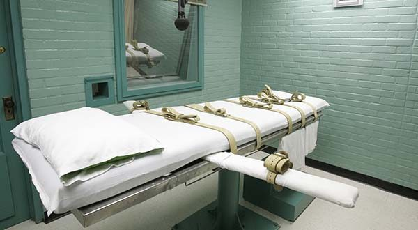 In this May 27, 2008 file photo, the gurney in Huntsville, Texas, where Texas' condemned are strapped down to receive a lethal dose of drugs. Wherever their summer travels have taken them, Supreme Court justices probably will weigh in over the next few days on Texas' plans to execute two death row inmates in the week ahead. (AP Photo/Pat Sullivan, File)