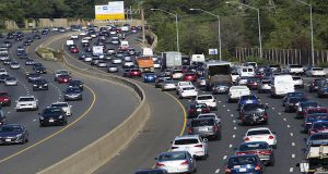 Traffic crawls along the Capital Beltway during rush hour, in Greenbelt, Md., Tuesday, Aug. 25, 2015. (AP Photo/Jose Luis Magana)