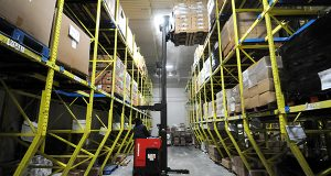 Anthony Dickenson, a Freezer Picking Clerk at the Maryland Food Bank, is shown here packing in 2011. The Baltimore area's industrial property market continues to perform well overall, despite a glut of supply being delivered.  (File)