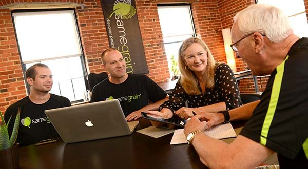 From Left, Jonathan Seale, Data Scientist; Eric Eller, CEO and Co- Founder; Anne A. Balduzzi, Founder and Chief Marketing Officer; and Ron Diegelman, CFO and Co-Founder at Samegrain, working at a table in their office. (The Daily Record/Maximilian Franz)