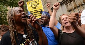 Members of the Peoples Power Assembly celebrate on Thursday after a Baltimore judge ruled not to change the venues for the criminal trials of  six police officers charged in the death of Freddie Gray. (The Daily Record / Maximilian Franz)