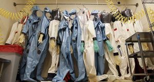 In this Aug. 10, 2011, file photo, biohazard suits hang in a Biosafety Level 4 laboratory at the U.S. Army Medical Research Institute of Infectious Diseases at Fort Detrick, Md. Army Secretary John McHugh on Friday, has suspended operations at four Defense Department laboratories, including at USAMRIID, that handle biological toxins, as the military scrambles to explain and correct problems that led to the accidental shipment of live anthrax to dozens of other labs around the country and the world. (AP Photo/Patrick Semansky)
