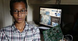 Irving MacArthur High School student Ahmed Mohamed, 14, poses for a photo at his home in Irving, Texas on Tuesday. Mohamed was arrested and interrogated by Irving Police officers on Monday after bringing a homemade clock to school. Police don't believe the device is dangerous, but say it could be mistaken for a fake explosive. He was suspended from school for three days, but he has not been charged. (Vernon Bryant/The Dallas Morning News via AP)