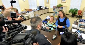 Rowan County Clerk Kim Davis, right, talks with David Moore following her office's refusal to issue marriage licenses at the Rowan County Courthouse in Morehead, Ky., on Tuesday. Although her appeal to the U.S. Supreme Court was denied, Davis still refuses to issue marriage licenses.  (Timothy D. Easely/AP Photo)