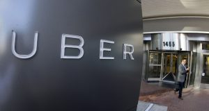 A man leaves the headquarters of Uber in San Francisco in 2014. (AP Photo/Eric Risberg, File)