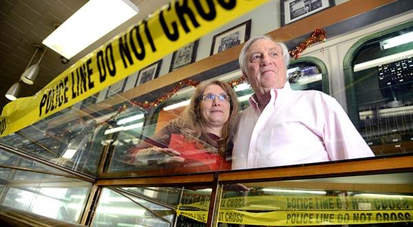 Marcia Lakein, vice president of Lakein's Jewelry Co., and her father, Warren Lakein, president of Lakein's Jewelry Co., stand behind a broken display case that is wrapped with police tape that still has not yet been repaired from a break-in during the riot on the evening of April 27th in Baltimore. (The Daily Record/Maximilian Franz)