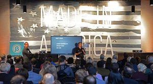 Win Smith, Co-Founder of Alchemy Learning, and presenter for the company. pitches at the 2015 Beta City event at City Garage in Port Covington. (The Daily Record / Maximilian Franz)