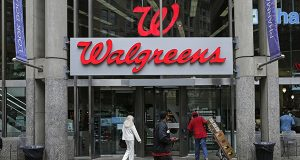This June 4, 2014, file photo shows a Walgreens retail store in Boston. Walgreens confirmed Tuesday, Oct. 27, 2015, that it will buy rival Rite Aid, creating a drugstore giant with nearly 18,000 stores around the world. (AP Photo/Charles Krupa, File)