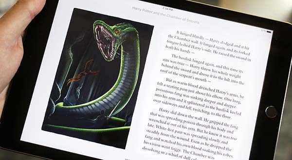 """Text and an illustration from """"Harry Potter and the Chamber of Secrets"""" are displayed on an iPad. The J.K. Rowling books are being released with animated or interactive illustrations, but only through Apple's iBooks Store and require the use of an Apple mobile device or a Mac computer. (AP Photo/Mark Lennihan)"""