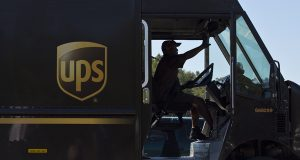 A United Parcel Service (UPS) truck driver enters a company warehouse in Birmingham, Ala., Sept. 20, 2014. (AP Photo/Brynn Anderson, File)