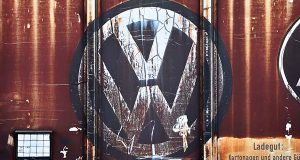 A Volkswagen logo is seen on a freight car at the VW factory in Zwickau, Gemany, in October. (Jan Woitas/dpa via AP)