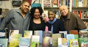 From left- Co-Owners Michael and Robyn Evans with founders Barbara and Clifford Evans at Expressions bookstore on N. Paca Street near Lexington Market. (The Daily Record/Maximilian Franz)