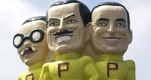 FILE - This file photo from July 31, 2003 shows Pep Boys mascots Manny, Moe, and Jack above a store location in West Philadelphia. Tire and auto service company Bridgestone on Monday said it is buying auto parts and repair company Pep Boys in a deal that will help it gain a more dominant position. (AP Photo/Mark Stehle, File)