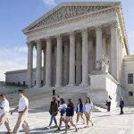 Justices reject request to rehear union case that tied 4-4