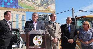 Caves Valley Partners' Arthur Adler speaks at a ceremony to mark the beginning of construction at Towson Row.  He is joined by, from left, Baltimore County Executive Kevin Kamenetz; County Councilman David Marks,  Councilman Julian E. Jones Jr. and Councilwoman Cathy Bevins, who is chair of the council. (The Daily Record / Adam Bednar)