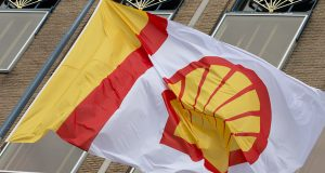 A flag bearing the company logo of Royal Dutch Shell, an Anglo-Dutch oil and gas company, flies outside the head office in The Hague, Netherlands April 7. Iran's state TV is reporting that Royal Dutch Shell and France's Total will be the first foreign companies to be allowed to operate gasoline stations inside Iran (AP Photo/Peter Dejong, File)