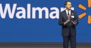 Wal-Mart Chief Executive Officer Doug McMillon speaks at the company's shareholder meeting in Fayetteville, Ark., June 5. On Friday, Wal-Mart laid off 450 workers at its headquarters in Bentonville, Ark., as the world's largest retailer attempts to become more nimble to compete with the likes of Amazon.com. (AP Photo/Danny Johnston)
