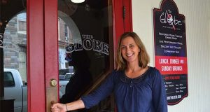 "Jennifer Dawicki, owner of The Globe Restaurant and Bar in Berlin, Md., attributes the business's 10-year growth to community support, an entrepreneurial mindset, and being in ""America's Coolest Small Town."" (Capital News Service / Bethany Hooper)"