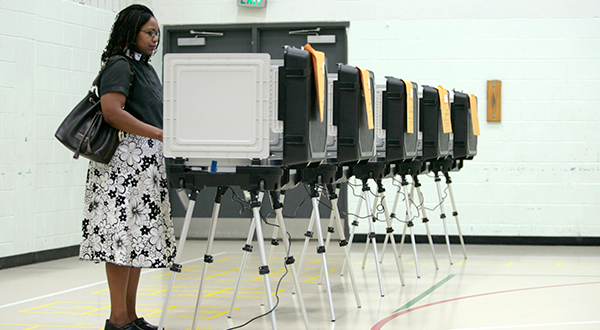 Rev. Glenna Reed, of Highlandtown, stops by Hampstead Hill Elementary School to cast her vote in the primary election in 2011.(File)