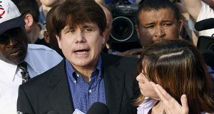 In this March 14, 2012 file photo, former Illinois Gov. Rod Blagojevich speaks to the media outside his home in Chicago as his wife, Patti, wipes away tears a day before he was to report to a prison in Littleton, Colo. Imprisoned ex-Illinois Blagojevich asked the U.S. Supreme Court on Tuesday, Nov. 17, 2015, to hear an appeal of his corruption convictions that included his attempt to sell an appointment to President Barack Obama's old Senate seat. (AP Photo/M. Spencer Green, File)
