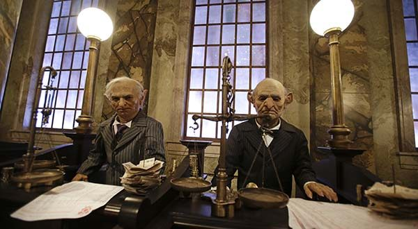 This 2014 photo shows animatronic bank tellers at Gringotts Bank, part of The Wizarding World of Harry Potter - Diagon Alley at Universal Orlando. Orlando's theme park attractions make it an appealing destination for business travelers as well as leisure tourists. Conventions and conferences often book attractions like the Harry Potter park for exclusive after-hours access for their attendees. (AP Photo/John Raoux, File)