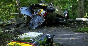 In this 2008  photo, wreckage from the medical helicopter that crashed lies on its side at Walter Mill Regional Park in District Heights, Md. Maryland will unveil a monument Friday for the four people killed in the 2008 crash of a State Police helicopter.  (AP Photo/Jose Luis Magana, File)