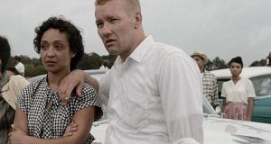 "In this Sept. 29, 2015 photo provided by Big Beach Films, Joel Edgerton, right, and Ruth Negga, as Richard and Mildred Loving, stand on the set of the movie ""Loving,"" being shot in the Richmond Va. area. Nearly 60 years after a Virginia couple defied a state law prohibiting interracial marriage, starting a battle that eventually overturned such laws nationwide, their story is heading to the big screen. (Ben Rothstein/Big Beach Films via AP)"