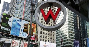 In this Wednesday, July 31, 2013, file photo, the logo for the W Hotel, owned by Starwood Hotels & Resorts Worldwide, is seen in New York's Times Square.  (AP Photo/Mark Lennihan, File)