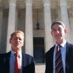 Maryland residents Stephen Shapiro, right, and John Benisek stand in front of the Supreme Court in Washington on Wednesday after a hearing in their case involving redistricting heard by the high court. Shapiro and Benisek are two of three Maryland residents who initially sued claiming the state's congressional districts, as they were redrawn in 2011, violated their First Amendment and other rights. (Jessica Gresko/Associated Press)