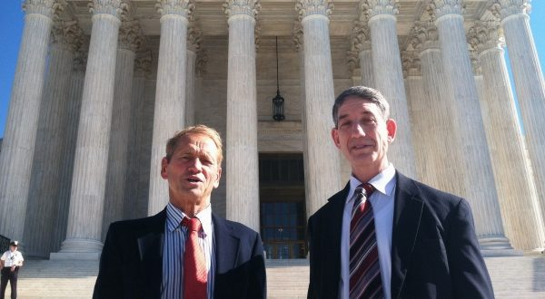 Maryland residents Stephen Shapiro, right, and John Benisek stand in front of the Supreme Court in Washington in 2015. (Jessica Gresko/Associated Press)