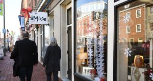 Shoppers in Fells Point in Baltimore. (Maximilian Franz/The Daily Record)