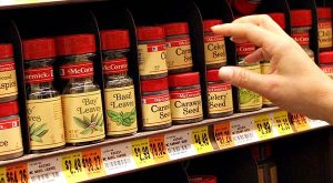 A shopper reaches toward a display of McCormick spices and flavorings. (Tim Fadek/Bloomberg News.)