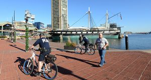 Police on bikes patrol the Inner Harbor last month. Baltimore tourism officials say they do not anticipate the trials of the six police officers charged in connection with the death of Freddie Gray to hurt the city's tourism industry. (File photo)