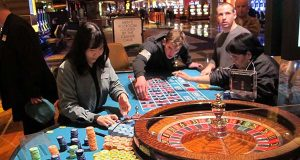 In this April 17, 2015 photo, a dealer counts chips during a game of roulette at the Tropicana Casino and Resort in Atlantic City, N.J. (AP Photo/Wayne Parry)