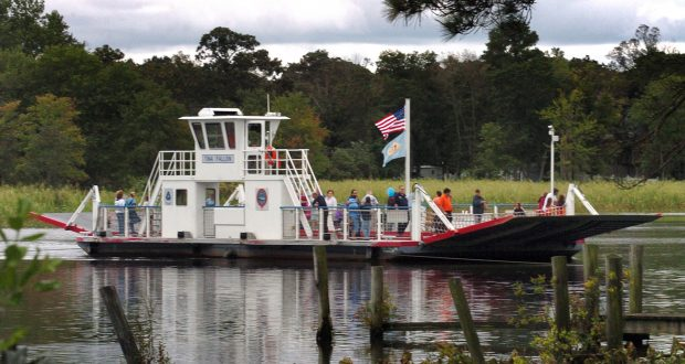 """In this 2009 photo, the ferry """"Tina Fallon"""" crosses the Nanticoke River with a load of passengers bound for the annual Woodland Ferry festival in Woodland, Del. The Chesapeake Conservancy has launched a virtual tour of the Nanticoke River, just in time for armchair kayak season. The new release allows users to travel the 64 navigable miles from the upper reaches in Delaware to Tangier Sound in Maryland. (Gary Emeigh/The News Journal via AP)"""