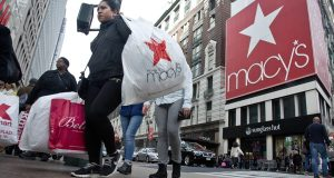 Shoppers carry bags as they cross a pedestrian walkway near Macy's in Herald Square in New York.  Overall holiday spending rose 7.9 percent from a year ago, according to the MasterCard SpendingPulse report, which tracks retail sales across cards, cash and checks from Black Friday to Christmas Eve. The uptick was driven by people sitting in the comfort of their homes or at work, with online shopping up 20 percent..  (AP Photo/Bebeto Matthews)