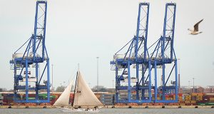 A historic Skipjack sails past the cranes in 2015 at the Port of Baltimore illustrating the diverse amount of maritime history that lies along the shores of the Chesapeake Bay. (The Daily Record/Maximilian Franz)