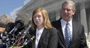 In this Oct. 10, 2012, file photo, Abigail Fisher, the Texan involved in the University of Texas affirmative action case, accompanied by her attorney Bert Rein, talks to reporters outside the Supreme Court in Washington. Consideration of race in college admissions is again in line of fire at the Supreme Court on Wednesday, Dec. 9, 2015, for the second time in three years, in the case of Fisher, a white Texas woman who was rejected for admission at the University of Texas. (AP Photo/Susan Walsh)